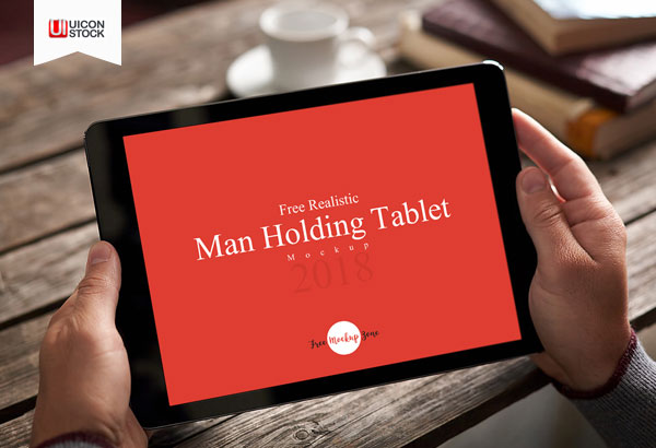 Free-Realistic-Man-Holding-Tablet-Mockup-2018