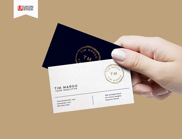 Free-PSD-Hand-Holding-Business-Cards-Mockup-2018