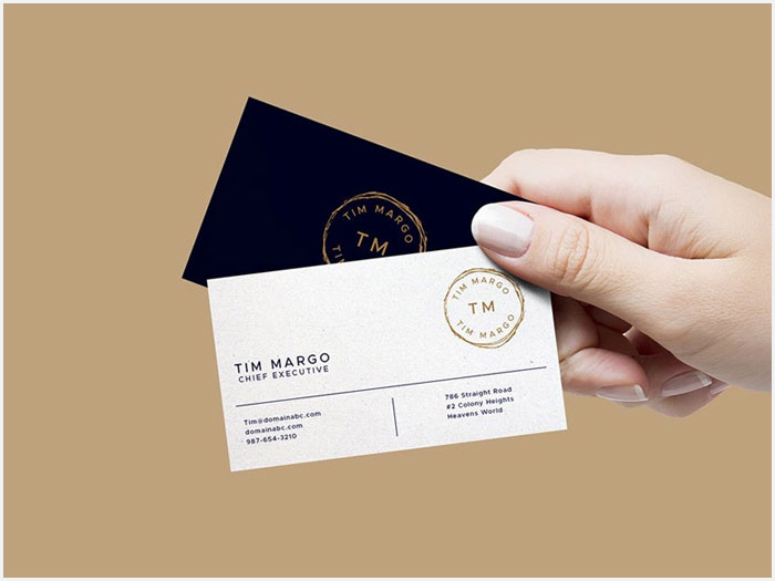 Free-Hand-Holding-Business-Cards-Mockup-PSD-2018-1