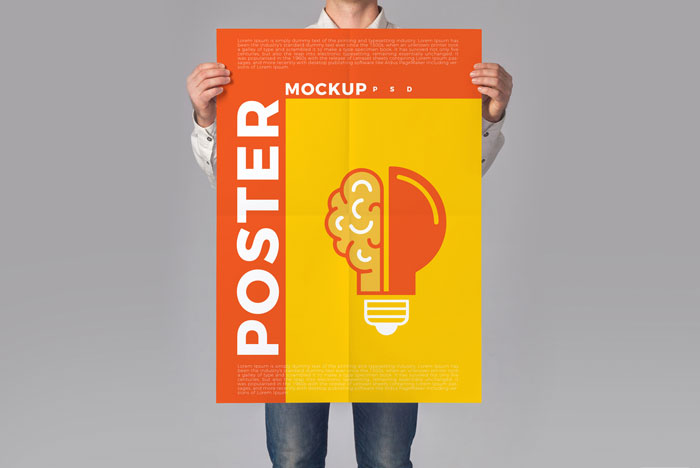 Man-Holding-Poster-Mockup-PSD-To-Showcase-Creative-Designs