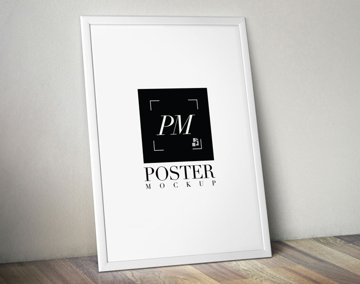 Poster-Frame-on-Wooden-Background-MockUp-PSD