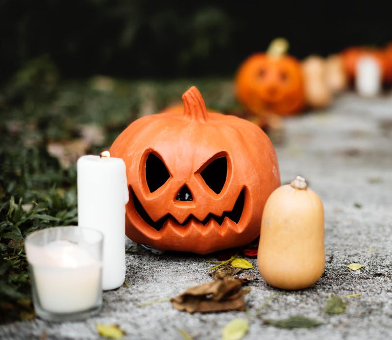 Halloween-Pumpkin-With-Candle-Near-Jack-o-Lantern
