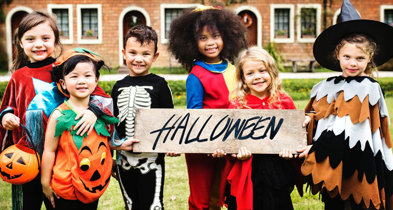 Kids-Wearing-Halloween-Costume-With-Banner