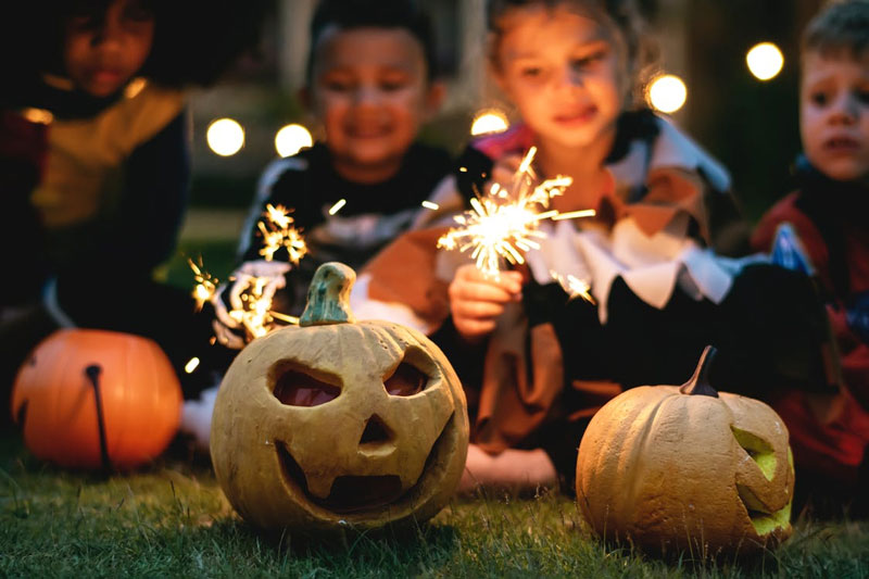 Outdoor-Children-Holding-Firecrackers-Halloween