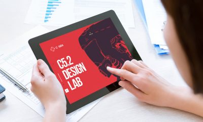 Free-Woman-Holding-Modern-Digital-Tablet-Mockup-PSD-2018